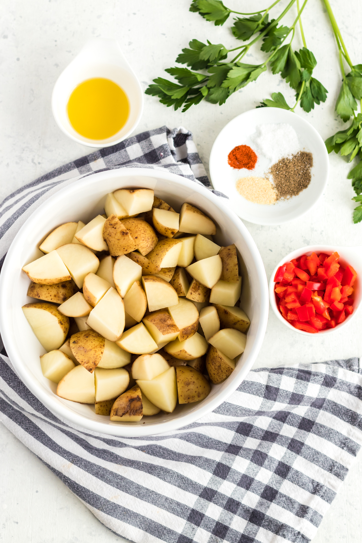 All the ingredients required to make potatoes in an air fryer.