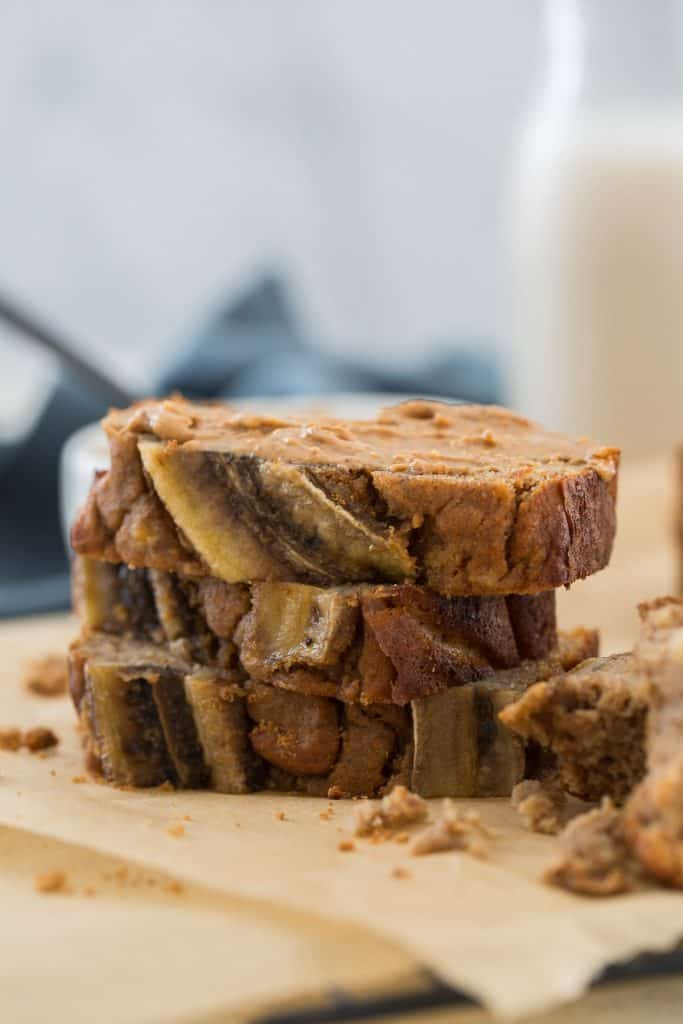 stacked sliced paleo banana bread topped with almond butter
