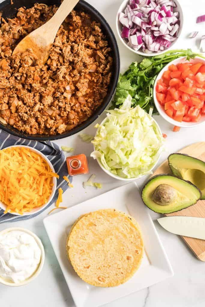 The cooked ground turkey, tortillas and optional toppings.