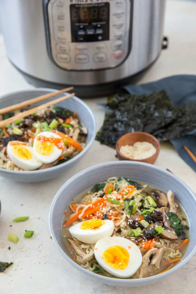 low sodium ramen in blue bowls with nori and instant pot in background