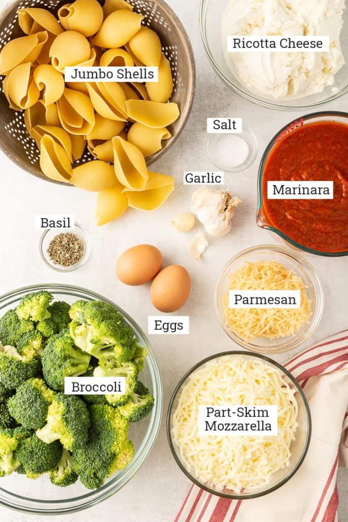 All the ingredients to make Broccoli Cheese Stuffed Shells with text overlay.