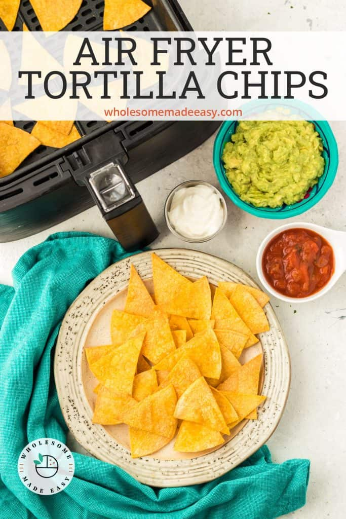 A bowl of tortilla chips with salsa and guacamole.