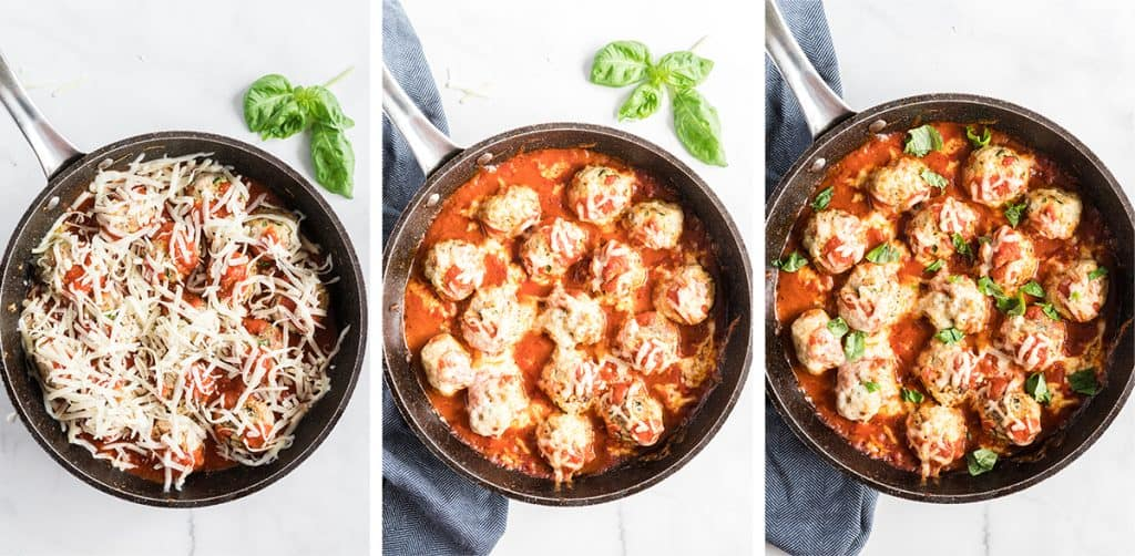 Meatballs topped with shredded cheese and marinara sauce in a skillet.