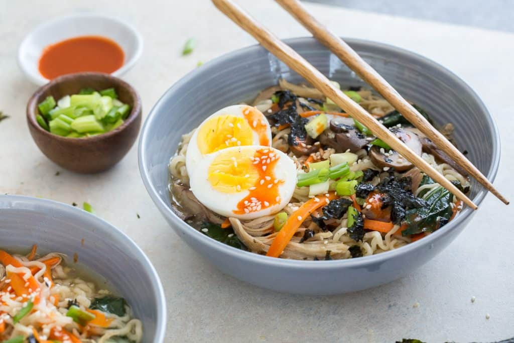 A bowl filled with ramen and a soft boiled egg.