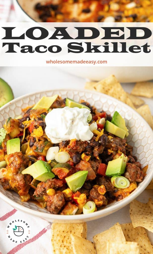 A white bowl filled with Loaded Taco Skillet with text overlay.