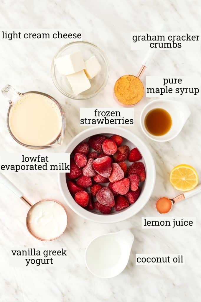ingredients for strawberry cheesecake popsicles on table