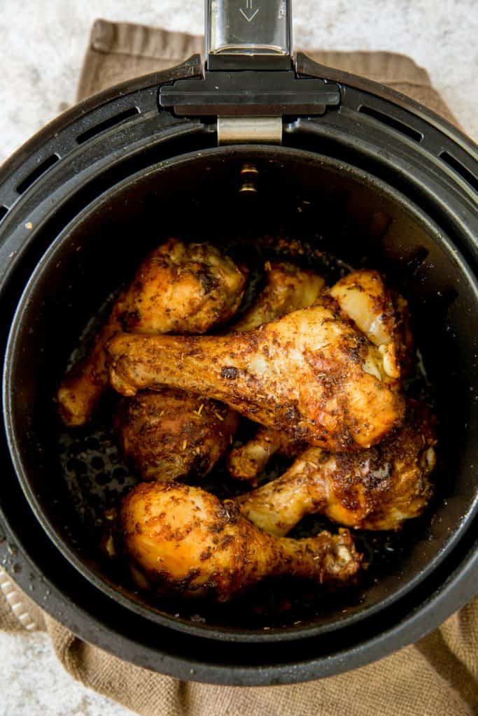 Cooked chicken drumsticks in an air fryer