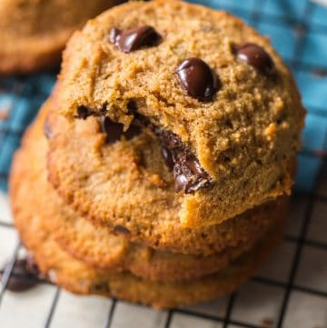 stack of paleo chocolate chip cookies with a bite taken