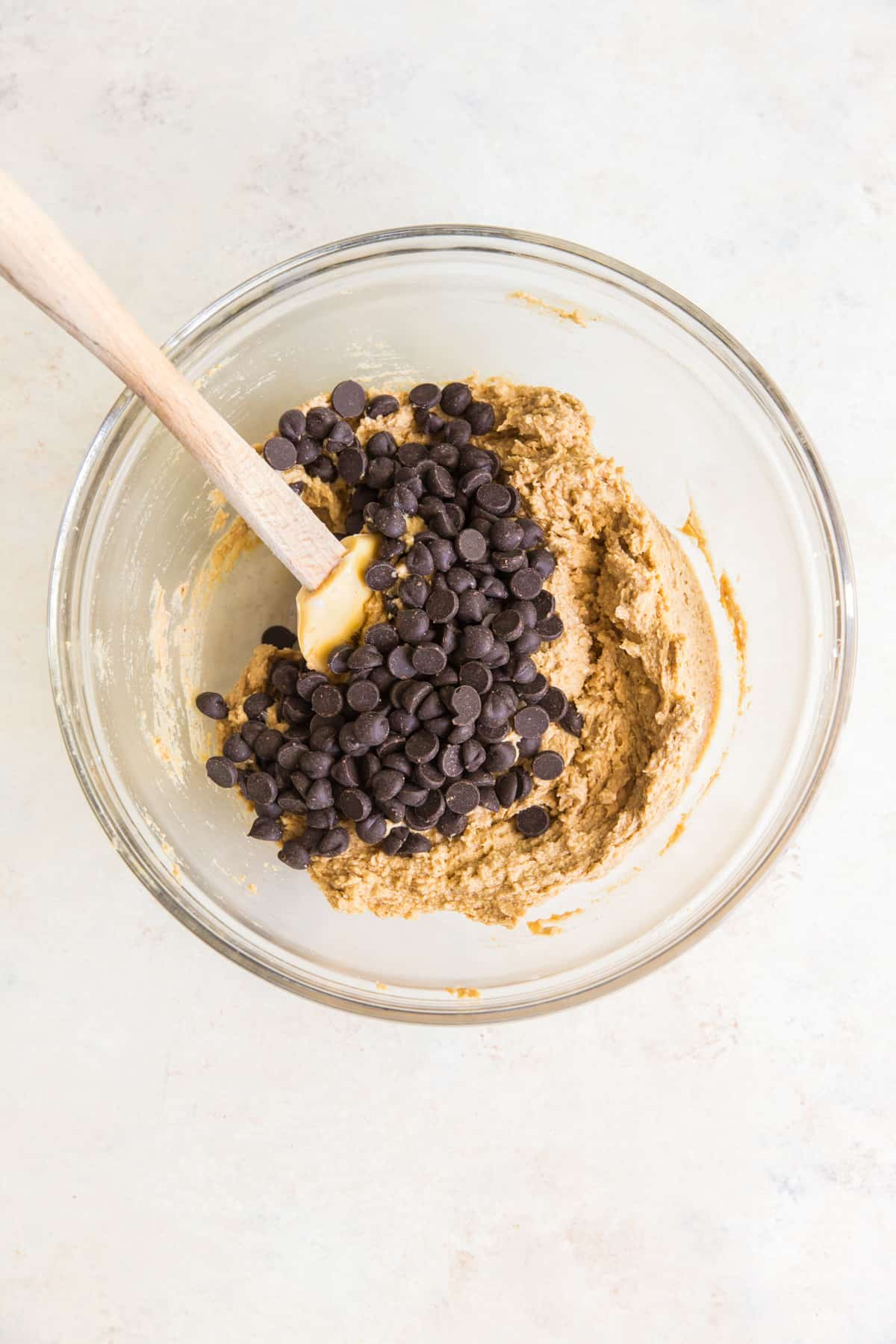image of mixing in chocolate chips into cookie dough