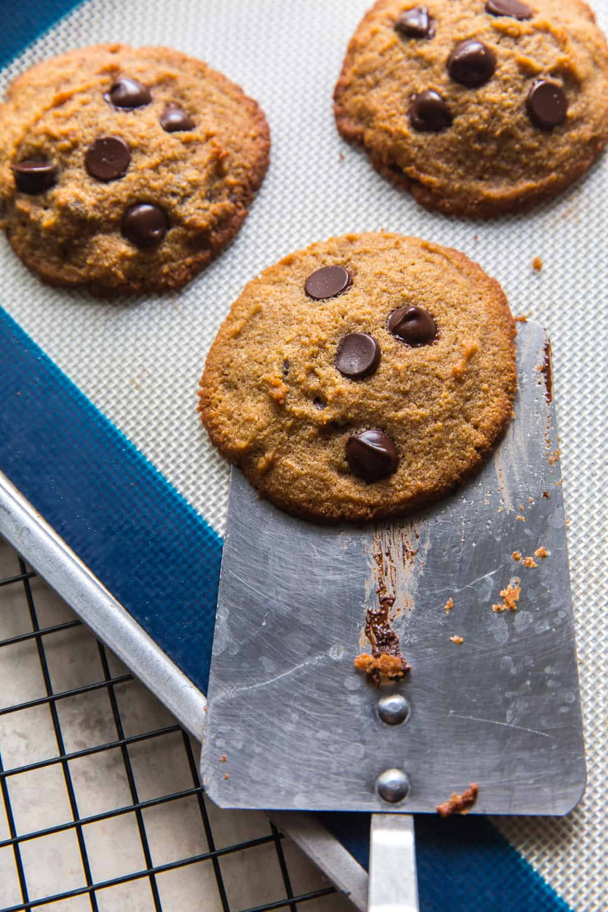 image of removing a cookie from a baking sheet with a spatula