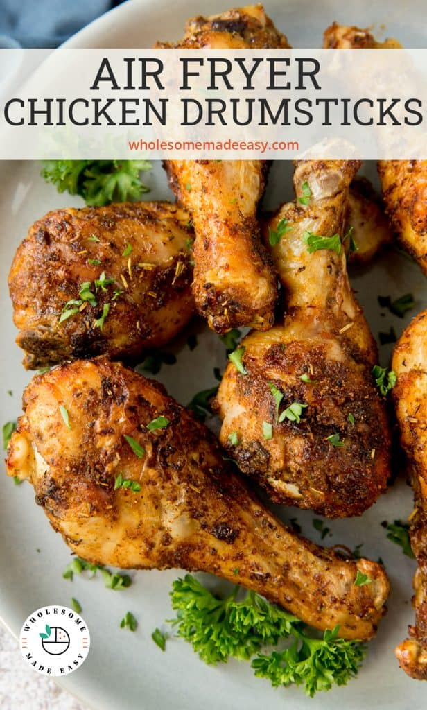 Air Fried Chicken Drumsticks on a white plate with text overlay.