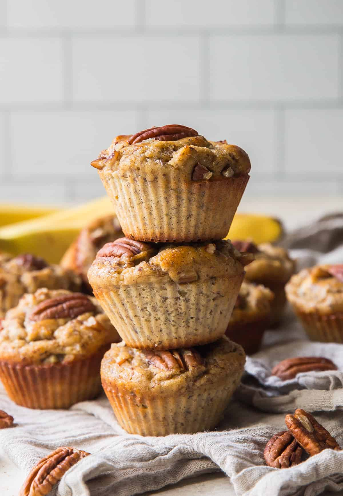 A stack of three Banana Pecan Protein Muffins.