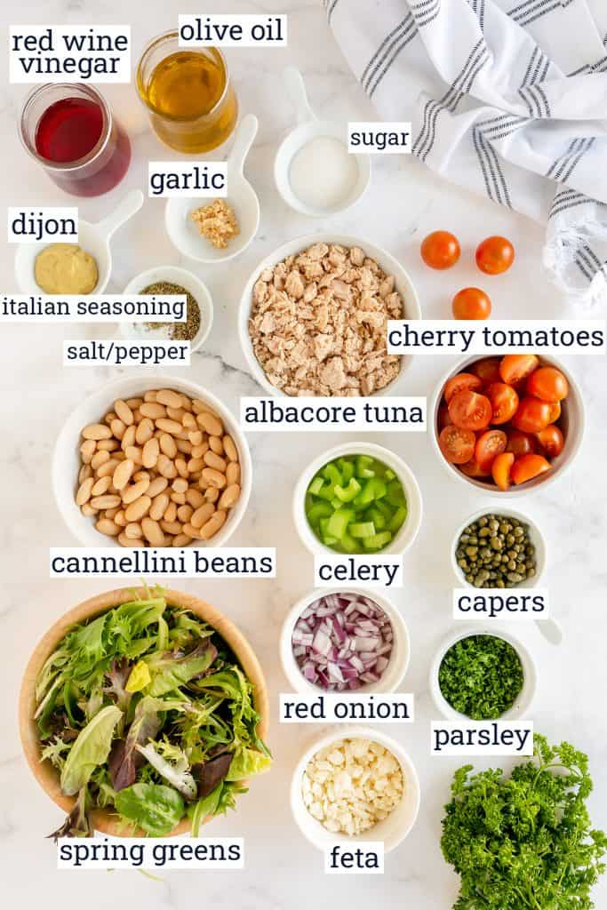 The ingredients to make Tuna White Bean Salad with text overlay.