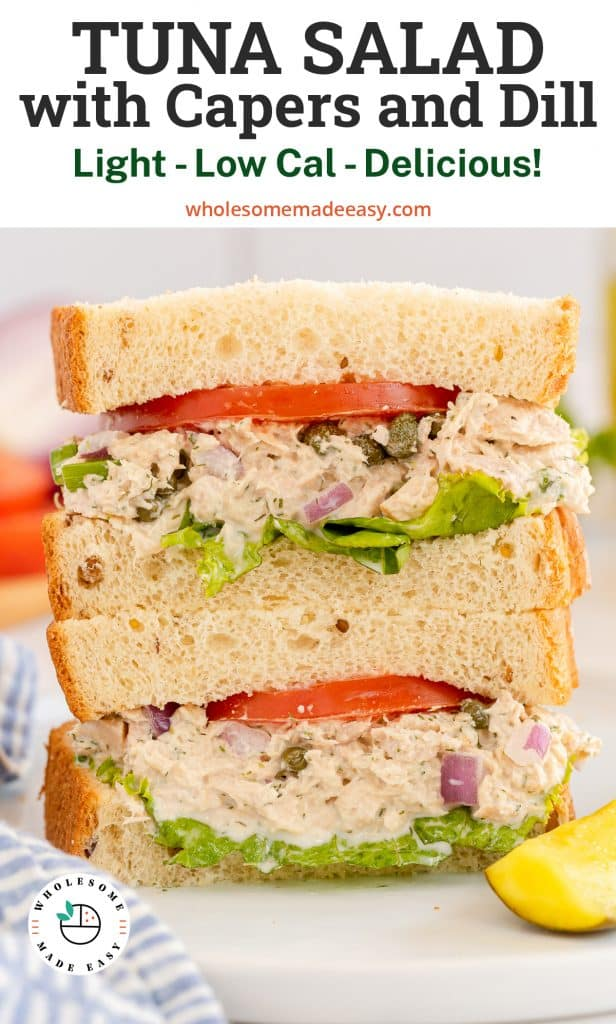 A tuna sandwich cut in half and stacked on a plate with overlay text.