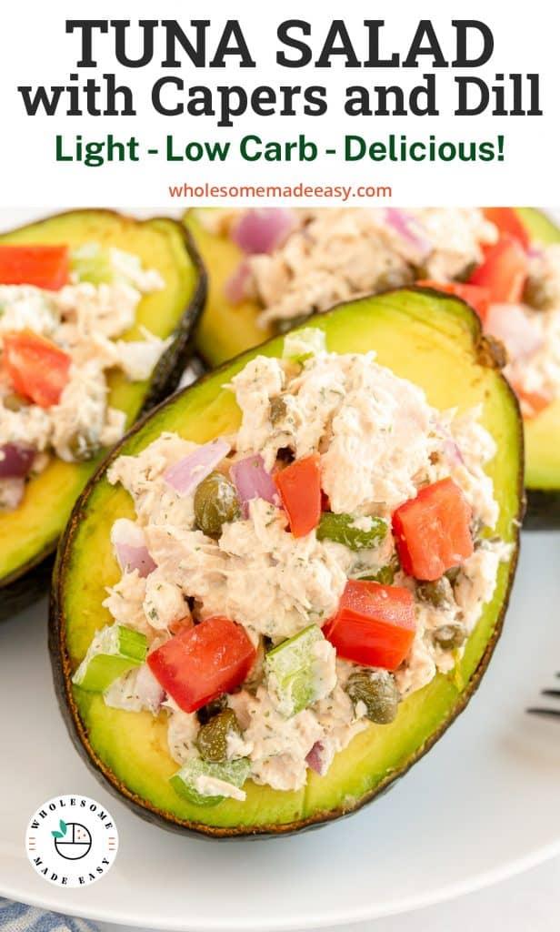 Half of an avocado stuffed with tuna salad with overlay text.