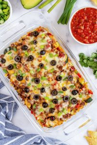 A casserole dish filled with Beef and Veggie Taco Bake shot from over the top.