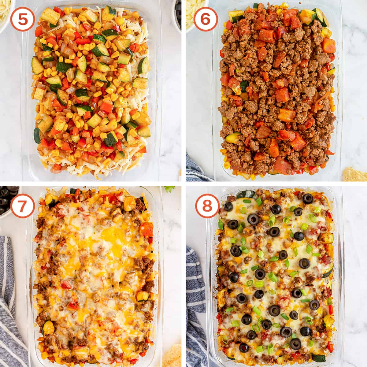 Vegetables and beef are topped with cheese and olives in a casserole dish.